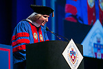 Marty Wilke, broadcast television executive and DePaul alumna, addresses the graduating class after receiving an honorary degree Sunday, June 11, 2017, during the DePaul University College of Computing and Digital Media and the College of Communication commencement ceremony at the Allstate Arena in Rosemont, IL. (DePaul University/Jamie Moncrief)