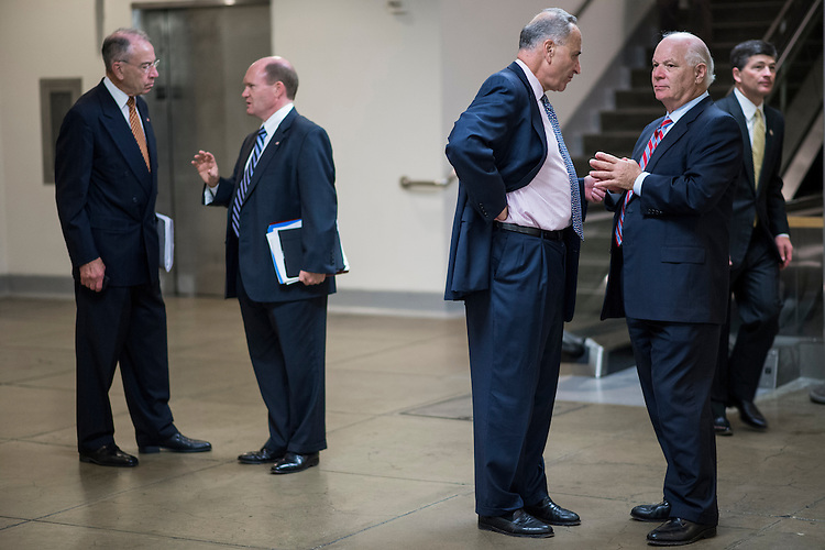 UNITED STATES - JULY 31: From left, Sen. Charles Grassley, R-Iowa, Sen. Chris Coons, D-Del., Sen. Charles Schumer, D-NY, and Sen. Ben Cardin, D-Md., talk in the Senate subway as Rep. Jeb Hensarling, R-Texas, walks by following the Senate policy luncheons on Tuesday, July 31, 2012. (Photo By Bill Clark/CQ Roll Call)
