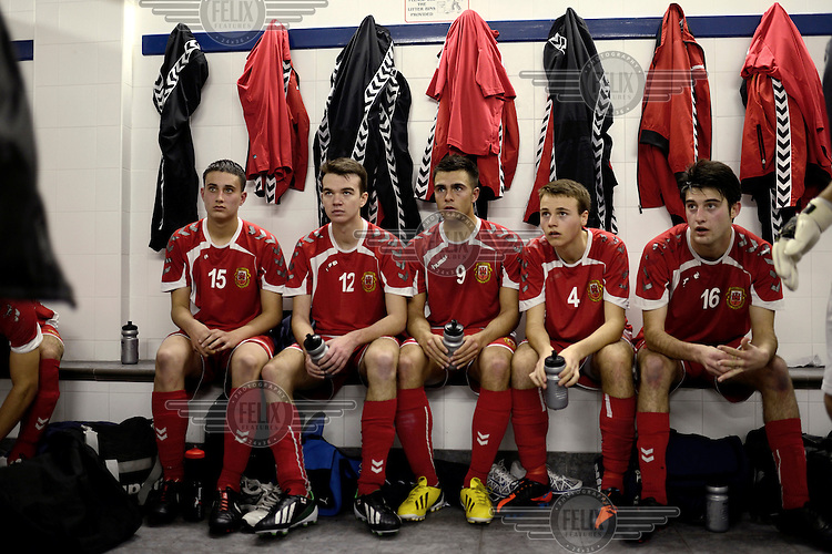 Players from the Gibraltarian under-17 national team  listen to their coach at half-time during a match against Northern Ireland played in March 2013. Although the United Nations doesn't recognise Gibraltar as an independent country, UEFA has recognised it and has granted the British Overseas Territory full UEFA membership.