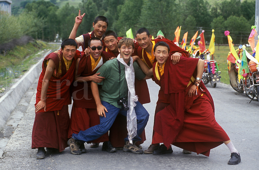 Tibetan Buddhist monks with Bodhi Garrett in the Zi-chu Valley - Kham, (Eastern Tibet), Sichuan Province, China