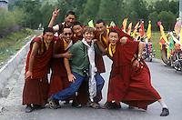 Tibetan Buddhist monks with Bodhi Garrett in the Zi-chu Valley - Kham, (Eastern Tibet), Sichuan Province, China