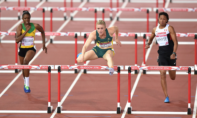 Australia's Sally Pearson clears the final hurdle on her way to winning gold in the women's 100m hurdles<br /> <br /> Photographer Chris Vaughan/CameraSport<br /> <br /> 20th Commonwealth Games - Day 9 - Friday 1st August 2014 - Athletics - Hampden Park - Glasgow - UK<br /> <br /> &copy; CameraSport - 43 Linden Ave. Countesthorpe. Leicester. England. LE8 5PG - Tel: +44 (0) 116 277 4147 - admin@camerasport.com - www.camerasport.com
