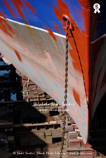 Ship's bow being repaint in dry dock (Licence this image exclusively with Getty: http://www.gettyimages.com/detail/94433144 )