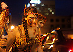 Madison Smith plays the role of a dead indian as she attempts to scare the drivers passing by before the Thriller Parade in downtown Lexington Friday night. Photo by Zach Brake | Staff