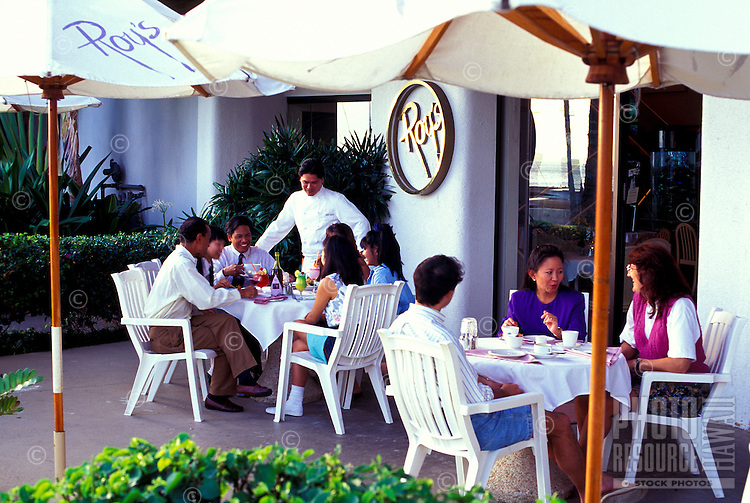 Chef Roy Yamaguchi (standing) greets patrons at his restaurant in Hawaii Kai, Oahu