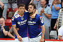 Jose Baxter of Oldham (r) is congratulated by Charlie MacDonald after scoring the winner<br />  Stevenage v Oldham Athletic - Sky Bet League 1 - Lamex Stadium, Stevenage - 3rd August, 2013<br />  © Kevin Coleman 2013