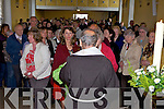 BLESSED: Fr Di Capua, the Capuchin priest who lived with Padre Pio for three years holds up the Saint's blessed glove for a devotee at a special service in St. Brendan's Church, Ballymac on Tuesday.