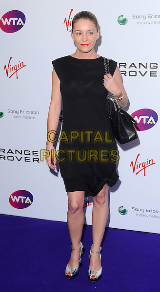 Nicola Stapleton.The WTA Tour Pre-Wimbledon Party, The Roof Gardens, Kensington, London, England..16th June 2011.full length black dress sleeveless bag purse .CAP/BEL.©Tom Belcher/Capital Pictures.