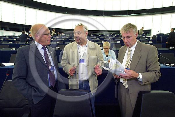 STRASBOURG - FRANCE  -20 JULY 2004--Mr. Ole CHRISTENSEN, Danish MEP for the PES Group, former MEP and spokesman John IVERSEN and fellow MEP Henrik DAM KRISTENSEN.--PHOTO: ERIK LUNTANG / EUP-IMAGES