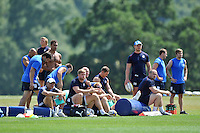 Players and coaches look on from the sidelines. Bath Rugby pre-season training session on July 16, 2013 at Farleigh House in Bath, England. Photo by: Patrick Khachfe/Onside Images