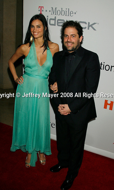 BEVERLY HILLS, CA. - February 07: Director Brett Ratner and guest  arrive at the 2009 GRAMMY Salute To Industry Icons honoring Clive Davis at the Beverly Hilton Hotel on February 7, 2009 in Beverly Hills, California.