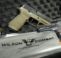 Wilson Combat in Berryville is working with gun maker Sig Sauer to provide custom work on two of the company's most popular handguns. This P320 Carry, seen Wednesday, March 4, 2020, features the Wilson Combat module starburst stipple pattern as well as improved machine work and the Wilson Combat logo. Visit nwaonline.com/200308Daily/ for today's photo gallery.<br /> (NWA Democrat-Gazette/Andy Shupe)