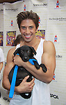 """Nick Adams in Priscilla Queen of the Desert attends Broadway Barks Lucky 13th Annual Adopt-a-thon - A """"Pawpular"""" Star-studded dog and cat adopt-a-thon on July 9, 2011 in Shubert Alley, New York City, New York with Bernadette Peters and Mary Tyler Moore as hosts.  (Photo by Sue Coflin/Max Photos)"""