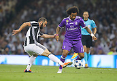 June 3rd 2017, National Stadium of Wales , Wales; UEFA Champions League Final, Juventus FC versus Real Madrid;  Marcelo of Real Madrid (R) evades the challenge from Gonzalo Higuain of Juventus (L)