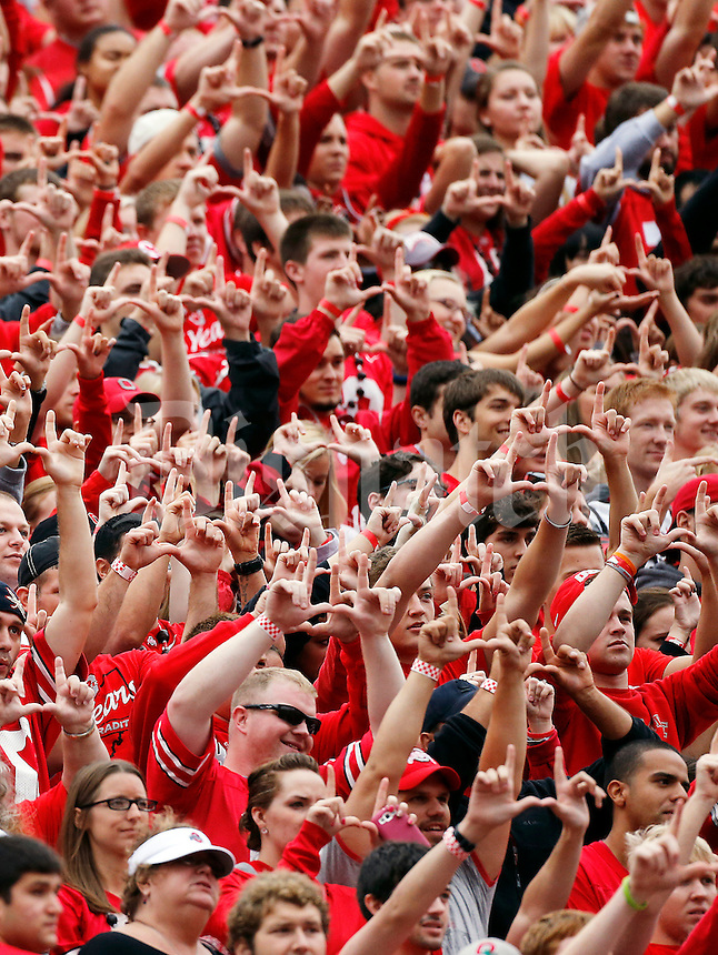 Ohio State's Block O student section holds up goalposts with their fingers as kicker Drew Basil (24) kicks a point after following a touchdown during the first quarter of the NCAA football game against Florida A&M at Ohio Stadium in Columbus on Sept. 21, 2013. (Adam Cairns / The Columbus Dispatch)