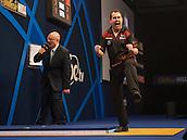21.12.2014.  London, England.  William Hill World Darts Championship.  Kim Huybrechts (18) [BEL] celebrates a winning leg in his match with Mickey Mansell [NIR]. Huybrechts won the match 3-0