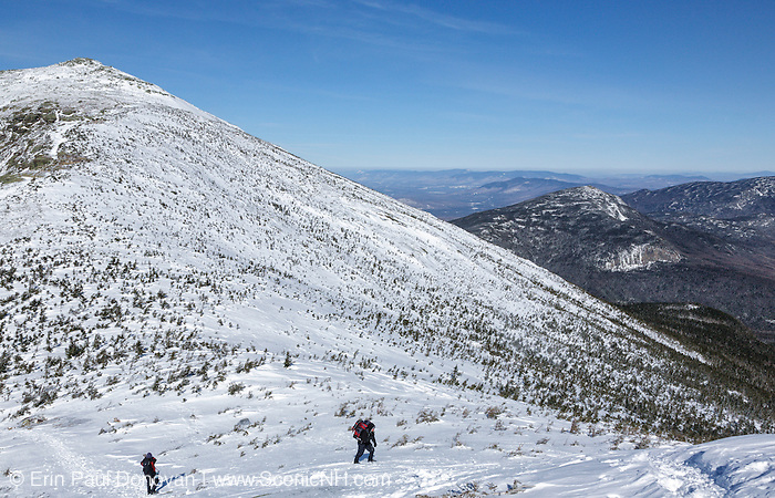 Hikers traveling south along the Appalachian Trail (Franconia Ridge Trail) in the New Hampshire White Mountains during the winter months.