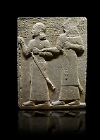 Hittite monumental relief sculpted orthostat stone panel of Royal Buttress. Basalt, Karkamıs, (Kargamıs), Carchemish (Karkemish), 900-700 B.C. Anatolian Civilisations Museum, Ankara, Turkey.<br /> <br /> King Araras holds his son Kamanis from the wrist. King carries a sceptre in his hand and a sword at his waist while the prince leans on a stick and carries a sword on his shoulder. <br /> <br /> Hieroglyphs reads; &quot;This is Kamanis and his siblings. I held his hand and despite the fact that he is a child, I located him on the temple. This is Yariris' image&quot;.  <br /> <br /> Against a black background.