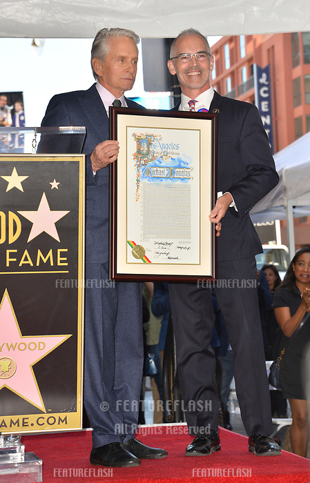 LOS ANGELES, CA. November 06, 2018: Michael Douglas & Mitch O'Farrell at the Hollywood Walk of Fame Star Ceremony honoring actor Michael Douglas.<br /> Pictures: Paul Smith/Featureflash