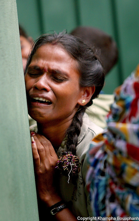 At the Ampara General Hospital, A Sri Lankan woman weeps over the lost of her family members killed during the tsunami on January 4, 2005.  (phot by Khampha Bouaphanh)