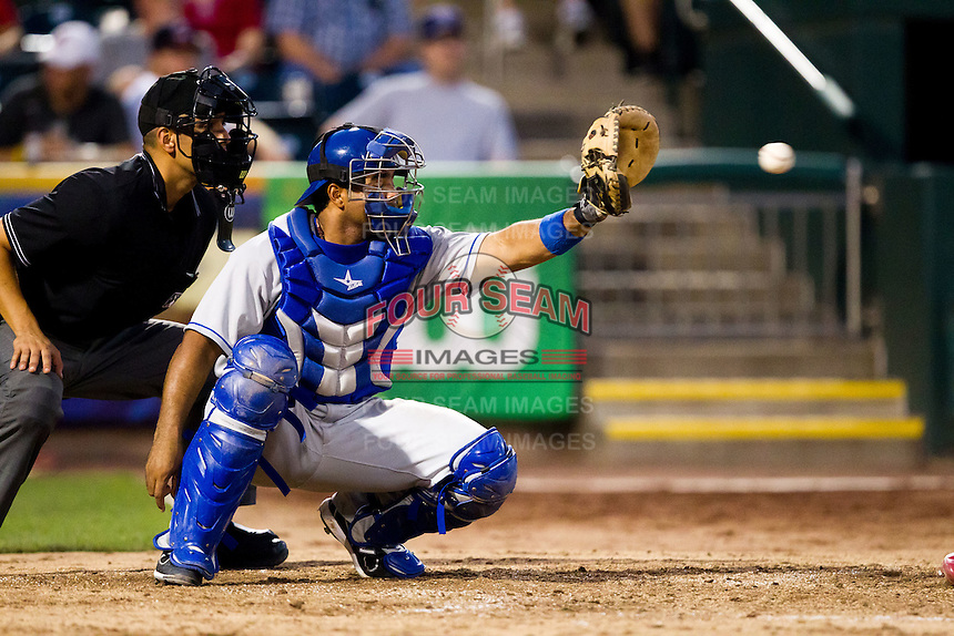 Wilin Rosario (20) of the Tulsa Drillers catches a pitch during a game against the Springfield Cardinals at Hammons Field on July 18, 2011 in Springfield, Missouri. Tulsa defeated Springfield 13-8. (David Welker / Four Seam Images)