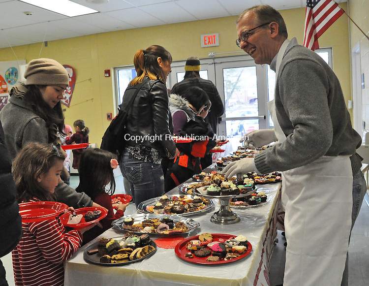 KENT, CT – 12 February 2014 - 021214LMW02 – Volunteer Tony Iovino enjoys his role of putting chocolate delicacies on plates during the 19th annual Chocolate Fest at Kent Center School Wednesday afternoon. The event benefits the Kent Center School Scholarship Fund, which is available to anyone who has attended Kent Center School. Lynn Mellis Worthington Republican-American