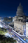 Havana, Cuba; a night scene of Central Park, the Capitol, the Gran Teatro, Hotel Inglaterra and passing cars, viewed from the roof of the Parque Central Hotel