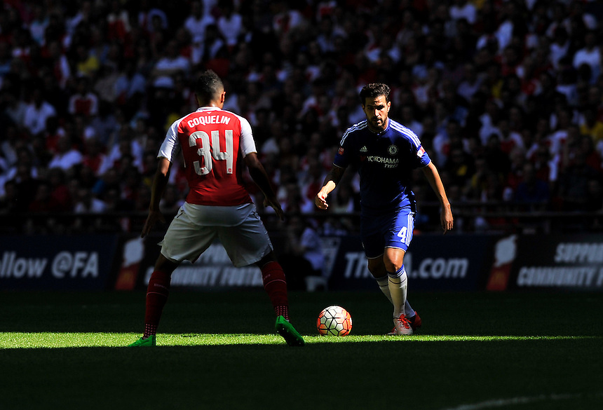 Chelsea's Cesc Fabregas holds off the challenge from Arsenal's Francis Coquelin<br /> <br /> Photographer Ashley Western/CameraSport<br /> <br /> Football - FA Community Shield - Arsenal v Chelsea - Sunday 2nd August 2015 - Wembley Stadium - London<br /> <br /> &copy; CameraSport - 43 Linden Ave. Countesthorpe. Leicester. England. LE8 5PG - Tel: +44 (0) 116 277 4147 - admin@camerasport.com - www.camerasport.com