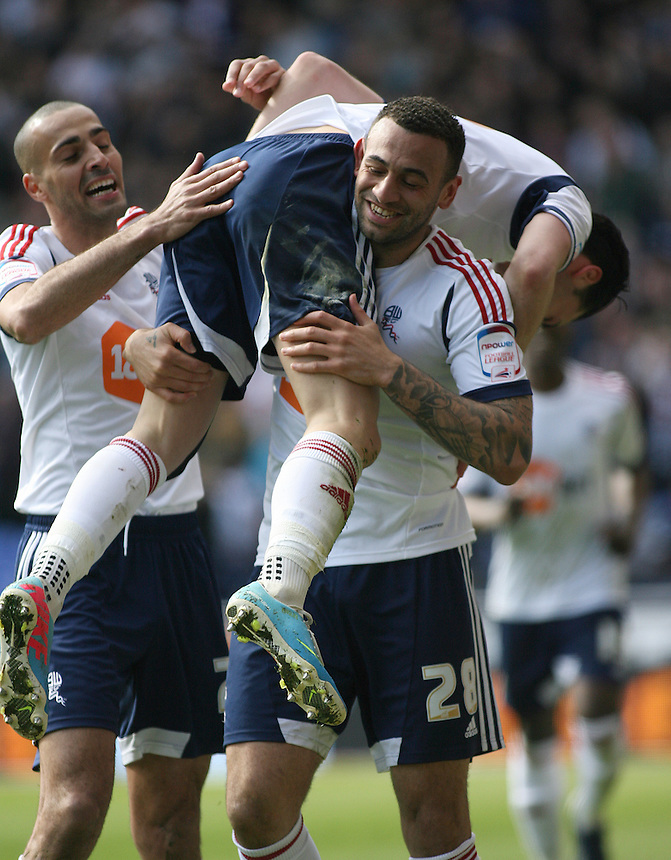 Bolton Wanderers' Chris Eagles celebrates scoring the opening goal by being lifted by team-mate Craig Davies .. - (Photo by Eric Whitehead/CameraSport) - ..Football - npower Football League Championship - Bolton Wanderers v Middlesbrough - Saturday 20th April 2013 - Reebok Stadium - Bolton..© CameraSport - 43 Linden Ave. Countesthorpe. Leicester. England. LE8 5PG - Tel: +44 (0) 116 277 4147 - admin@camerasport.com - www.camerasport.com