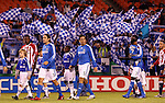 27 October 2007: Kansas City's Nick Garcia (3), Kerry Zavagnin (5), and Eddie Johnson (7) walk out in front of a backdrop of fans waiving flags. The Kansas City Wizards defeated Club Deportivo Chivas USA 1-0 in the first leg of their Major League Soccer Western Conference Semifinal playoff series at Arrowhead Stadium in Kansas City, Missouri.
