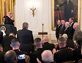 United States President Donald J. Trump acknowledges previous recipients during the ceremony where he will award the Medal of Honor to Sergeant Major John L. Canley, United States Marine Corps (Retired), for conspicuous gallantry during the Vietnam War in a ceremony in the East Room of the the White House in Washington, DC on Wednesday, October 17, 2018.<br /> Credit: Ron Sachs / CNP