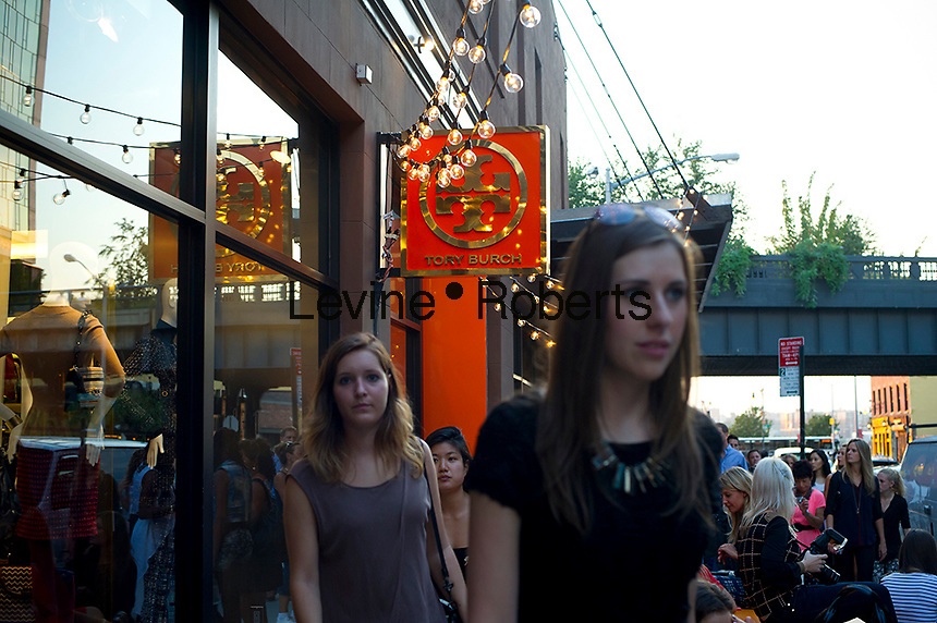 Hordes of shoppers on line outside the Tory Burch store in the trendy Meatpacking District in New York on Thursday, September 6, 2012 during the fourth annual Fashion's Night Out event. On the first evening of New York Fashion Week stores around the city offer sales and bargains as well as parties and events to entice customers to shop. The event has been so successful in boosting sales that over 100 cities in the US are having their own events, and Fashion's Night Out events occur in fashion-forward cities around the world. (© Frances M. Roberts)