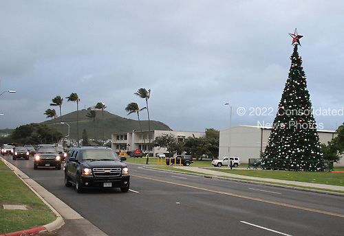 United States President Barack Obama's motorcade passes a decorated Christmas tree at Marine Corps Base Hawaii located in Kaneohe, Hawaii after playing a round of golf with friends, Saturday, December 24, 2011. .Credit: Cory Lum / Pool via CNP