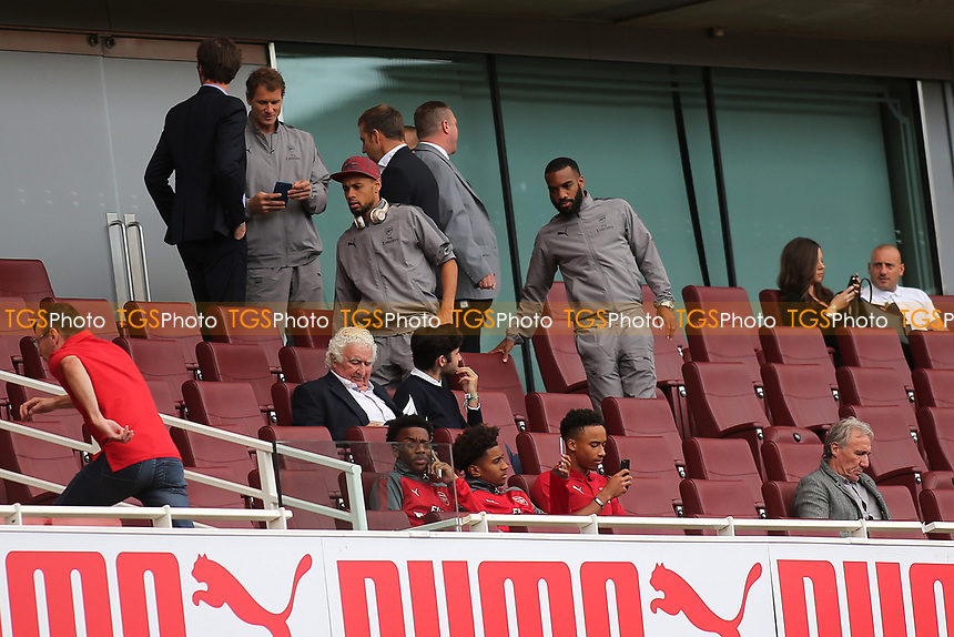 Alexandre Lacazette of Arsenal takes his seat in the stand to watch the match during RB Leipzig vs Sevilla, 2017 Emirates Cup Football at the Emirates Stadium on 29th July 2017