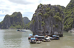 Halong-Vietnam, Ha Long - Viet Nam - 22 July 2005---Floating fisher village in characteristic landscape dominated by limestone rocks at Halong Bay, a UNESCO World Natural Heritage Site---landscape, nature, housing---Photo: Horst Wagner/eup-images
