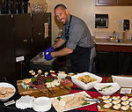 "Chef Christian Christensen prepares appetizers before the Reno Magazine ""Bubbles Tasting"" event at Total Wine in Reno on Friday night, February 9, 2018."