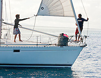 Father and son sailors preparing yacht for race