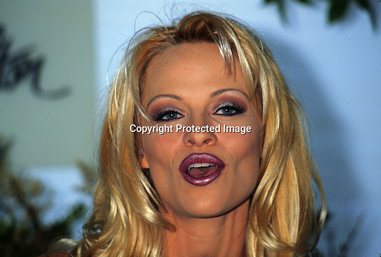 "©KATHY HUTCHINS/HUTCHINS.5/28/97 "" PAMELA ANDERSON LEE VICTORY PRESS CONFERENCE"".PAMELA ANDERSON LEE"