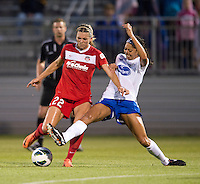 Stephanie Ochs (22) of the Washington Spirit has her shot blocked by Melinda Mercado (23) of the Boston Breakers during the game at the Maryland SoccerPlex in Boyds, MD.  Washington tied Boston, 1-1.