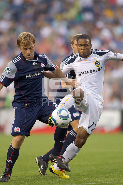 Los Angeles Galaxy forward Tristan Bowen (17) attempts to control the ball as New England Revolution defender Seth Sinovic (27) pressures. The New England Revolution defeated LA Galaxy, 2-0, at Gillette Stadium on July 10, 2010.