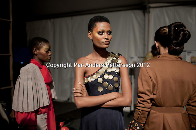 JOHANNESBURG, SOUTH AFRICA – MARCH 09: Models wait backstage before a show for the designer label David Tlale at the Joburg Fashion Week on March 09 2012, at the Hyde Park Mall in Johannesburg, South Africa. South Africa's finest designers showed their 2012 Autumn & Winter collections during the 4day event. (Photo by Per-Anders Pettersson)