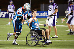 San Francisco Dragons vs Los Angeles Riptide.Lebard Stadium, Orange Coast College,Huntington Beach, California.Anthony Kelly (#34) wheels Cameron Piorek of Aliso Niguel High School onto the field, Piorek is paralyzed from the chest down as a result of a collision during a high school lacrosse game in April 2008.OM3D8506.JPG.CREDIT: Dirk Dewachter