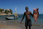 February 13, 2004. Cap Haitian, Haiti. A local fisherman displays his catch..