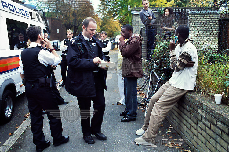 Jean-Claude (aka Vipoh) and his crew being issued an S60 by local police in South London. This controversial 'stop and search' policy was introduced to disperse groups of youths and prevent anti-social behaviour. It has been widely criticised, accusing police of targeting particular groups in poor areas, often of Black, Asian and mixed ethnicity. Vipoh's family fled violence in Ivory Coast (Cote d'Ivoire) in the late 1990s and settled between France and England.