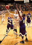 SIOUX FALLS, SD - MARCH 9:  Marcus Heemstra #32 from South Dakota State University takes the ball to the basket between Mike Miklusak #30, and Michael Ochereobia #52 from Western Illinois in the second half of their quarterfinal game at the 2014 Summit League Tournament Sunday evening in Sioux Falls, SD. (Photo by Dave Eggen/Inertia)