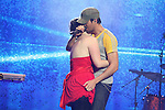Enrique Iglesias with a 16 year old fan on stage at the Cheerios Childline Concert 2008