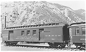 Railroad Post Office car #054 sits outside of Durango, CO in 1941. These cars were exactly what their name entailed; a post office on rails that sorted and delivered mail destined for locations along the rail route. Automotive power made these cars, like so many other aspects of railroading, obsolete. #054 has recently been restored by the Friends of the Cumbres &amp; Toltec to its former glory, and will take to the rails of the Rio Grande once again.<br /> D&amp;RGW  Durango, CO  Taken by Maxwell, John W. - 7/1/1941