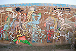 """Wheel of Kama"" --suggestive graffiti-art painted on the side of the old concrete water tanks at Slab City, Calif."