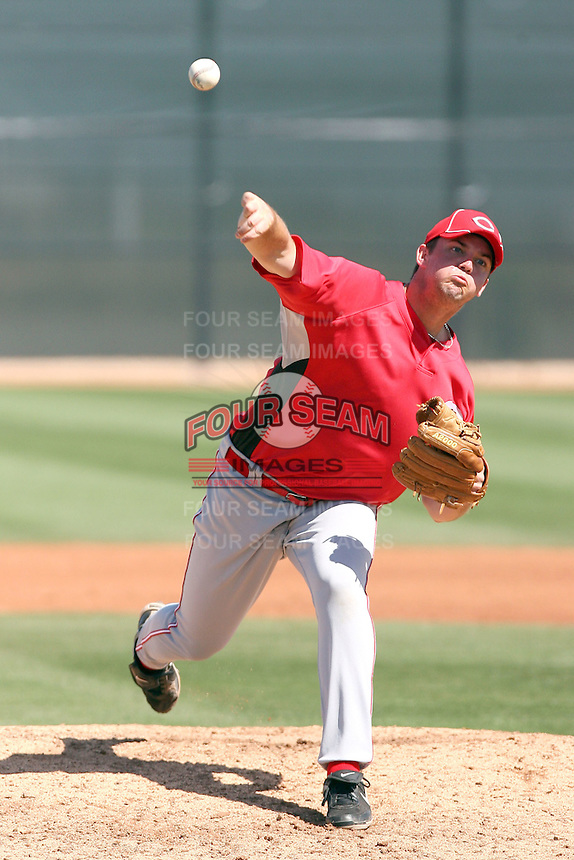 Mike Henry #61 of the Cincinnati Reds plays in a minor league spring training game against the Cleveland Indians at the Reds complex on March 26, 2011 in Goodyear, Arizona. .Photo by:  Bill Mitchell/Four Seam Images.