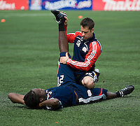 23 May 09: New England Revolution midfielder Shalrie Joseph #21 gets a  leg stretch during the warm-up in a game between the New England Revolution and Toronto FC..Toronto FC won 3-1.
